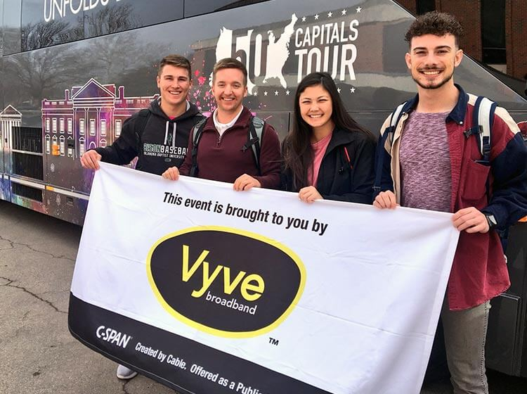 Shawnee students pose with a Vyve banner outside the CSPAN 50 Capitals Tour bus