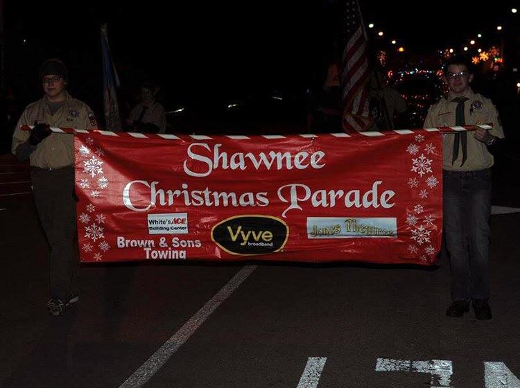 Boy Scouts carry the Shawnee Christmas Parade banner
