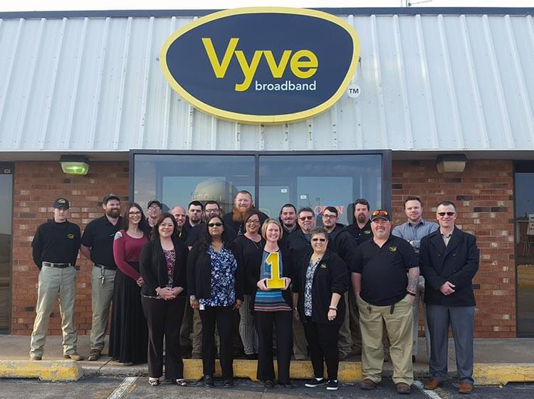 Vyve employees pose for a picture outside the Shawnee Vyve Headquarters