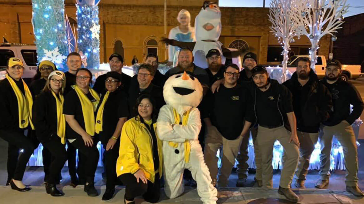 Vyve team posing with snowman during the Holidays